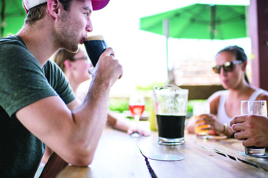 Customers drink beers on the patio at Green Bench Brewing.   Photo by Megan Klementowski/Nutmeg Imageworks.