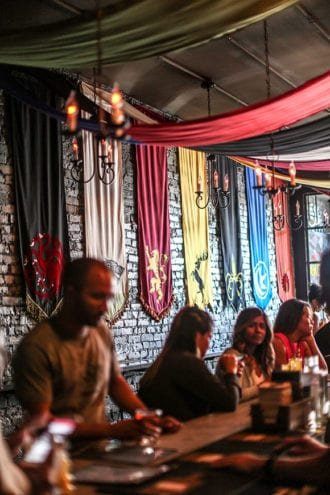 At the Game of Thrones pop-up in Washington, DC, house banners drape one of the rooms. | Photo by Farrah Skeiky.